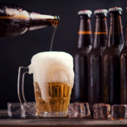 glass-bottles-beer-with-glass-ice-dark-background_1150-8899